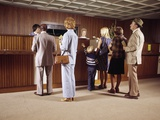 1970s Men Women Children Waiting in a Line in Bank for a Teller Photographic Print