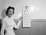 1950s-1960s Woman Nurse Pointing to Eye Chart Fotodruck