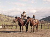 1970S Father and Son Sitting Together on Horses Photographic Print