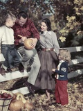 1950s Family Father Mother Son and Daughter Outdoor Carving a Pumpkin Photographic Print