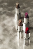 4 Lipsticks Different Colors Photographic Print
