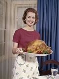 1960s Woman Serving Thanksgiving Turkey Dinner Photographic Print