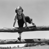 1940s-1950s Girl Climbing over Wooden Fence Photographic Print