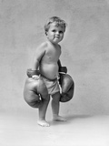 1930s Baby Boy Toddler Wearing Oversize Boxing Gloves Photographic Print