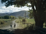 1960s Two Boys Brothers Walking Together Down a Summertime Farm Country Road Photographic Print