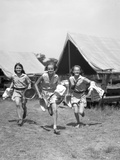 1930s Three Teen Girls Wearing Camp Shorts and Shirts Running from Tents Photographie