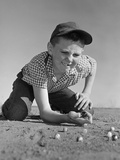 1950s-1960s Boy Playing Marbles Kneeling in the Dirt Squinting Missing a Front Tooth Photographic Print