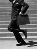 1960s Man in Suit Shown Chest-Down Running Past Set of Stairs with Briefcase in Hand Photographic Print