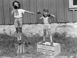 1930s-1940s Boys Playing Carnival Strongman ,One Lifting Dumbbells Other Announcing Act Valokuvavedos