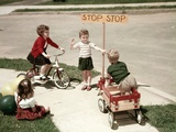 1950s Boys and Girls Outdoor with Tricycle and Wagon Playing Traffic with Police Stop Sign Photographic Print