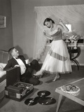 1950s-1960s Teen Couple Dressed for Prom, Girl Dancing to Music from a Record Player Photographic Print