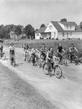 1950s 8 Kids Boys and Girls Ride Bicycles on Country Rural Road Lane Fun House in Background Photographic Print