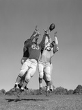 1960s Three Football Players Reaching to Catch Ball Photographic Print