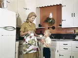 1970s Mother Handing Glass of Milk to Son in Kitchen Photographic Print
