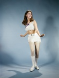 1970s Smiling Young Woman Dancing Wearing White Fringed Top Miniskirt and Go-Go Boots Photographic Print