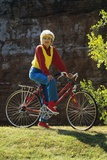 1980s Senior Woman on Bicycle Standing Still Looking at Camera Fotoprint