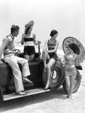 1920s-1930s Man and Three Women in Beach Clothes or Bathing Suits Posing with Car on Running Board Photographic Print