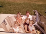 1960s-1970s Family Sitting in Open White Convertible Automobile Photographie