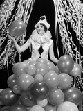 1920s-1930s Young Woman Pierrot Clown Amid Party Balloons and Paper Streamers Photographic Print