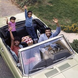 African-American Family Father Mother Son Daughter Waving from Convertible Car Outdoor 1970s Photographic Print