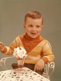 Boy Sitting at Ice Cream Parlor Table Eating Whipped Cream Cherry Topped Sundae Photographic Print