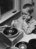 1960s-1970s Boy with Buzz Haircut Listening to Music on Portable 45 Rpm Phonograph Record Player Photographic Print
