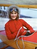 1940s Young Woman Sitting in Cockpit of Ice Boat Holding Sheet Rope to Sail Boom Photographic Print