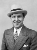 1930s Head and Shoulder Portrait of Smiling Man in Herringbone Suit Paisley Tie and White Hat Photographic Print