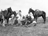 1920s-1930s Five Cowboys Sitting by Their Horses One Holds Guitar Singing Photographic Print