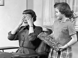 1950s Woman Mother Hands Covering Eyes as Girl Daughter Gives Her a Gift Present Photographic Print