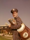 1960s Mailman Holding Mail Mailbag Letters Leather Mailbag in Suburban Neighborhood Photographic Print