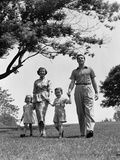 1950s Happy Family Mother Father Daughter Son Walking in Park Photographic Print