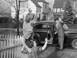 1950s Mother and Daughter Waving to Father Opening Automobile Door in Front of Suburban Home Photographic Print