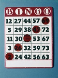 1960s Bingo Card with Red Markers in a Winning Game Photographic Print