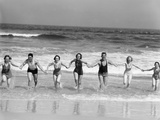 1930s Group 7 People Holding Hands Running Out of Surf onto Beach Photographic Print