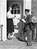 1930s Postman Giving a Letter to a Woman in the Doorway of a Colonial Brick Home Photographic Print