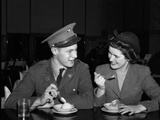 1940s Soldier in Army Uniform and Girlfriend Sitting at Soda Fountain Counter Eating Ice Cream Photographic Print