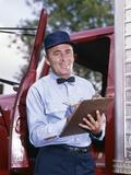 1950s-1960s Repairman in Uniform Holding Clipboard Standing in Open Door of Truck Cab Photographic Print