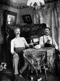 1890s Two Men in Shirt Sleeves Sitting at Table Drinking Bottles of Beer with Piano and Dog Photographic Print