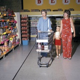1970s Two Women Small Girl Walking Down Supermarket Grocery Store Aisle Woman Pushing Cart Photographic Print