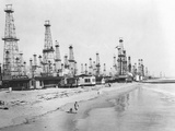 Oil Derricks on a Beach in California Photographic Print