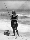 1920s Woman in Bathing Suit Costume Standing on Beach Putting Bait on Surf Fishing Pole Reprodukcja zdjęcia