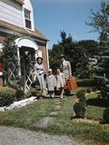 1940s-1950s Family Father Mother Daughter Son Leaving Suburban House Carrying Luggage Photographic Print