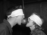 1950s Blindfolded Couple Trying to Eat an Apple Hanging in Air from a String Inside Photographic Print