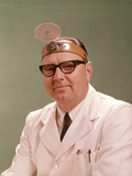 1950s-1960s Doctor Wearing Diagnostic Head Mirror on Forehead Photographic Print