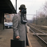 1950s Man Wearing Gas Mask Hat at Commuter Train Station Holding Briefcase Newspaper Photographic Print