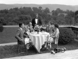 1920s-1930s Country Club Scene with Two Couples with Golf Clubs Having Lunch Outdoors Photographic Print