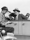 1920s Motorcycle Policeman Writing a Speeding Ticket to a Couple Sitting in Convertible Sedan Photographic Print
