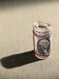 1970s Red Elastic Rubber Bands around Roll of One Dollar Bills Photographic Print