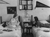1930s-1940s Two Teen Girls Lying on Dormitory Beds, Roommates Listening to the Radio Photographic Print